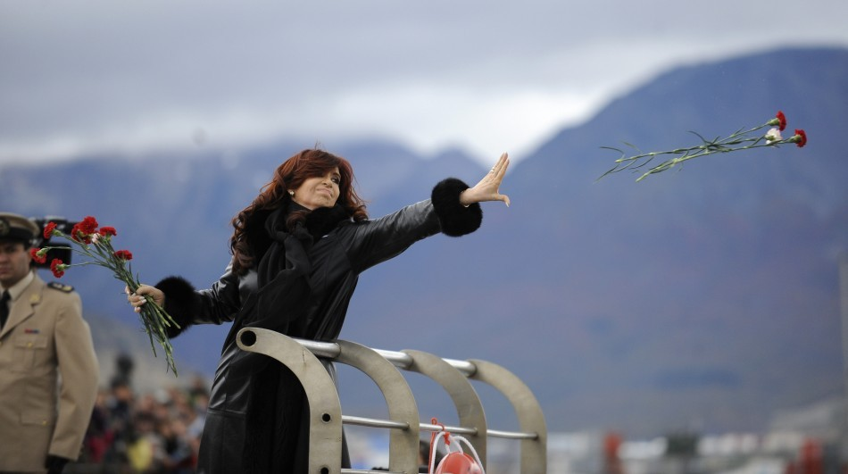 Argentine President Kirchner throws flowers into the water to pay homage to the fallen soldiers during the Falklands War in Ushuaia (Reuters)