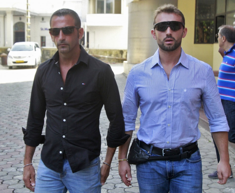 Italian sailors Salvatore Girone (R) and Massimiliano Latorre leave the police commissioner office in the southern Indian city of Koch