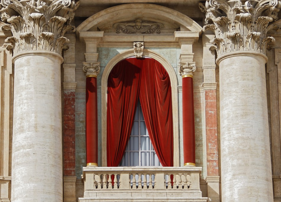 The red curtain on the central balcony, called the Loggia of the Blessings of Saint Peter's Basilica, where the new pope will appear after being elected in the conclave is seen at the Vatican