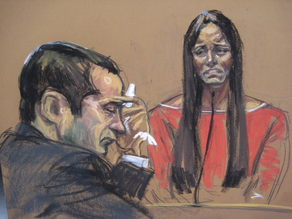 Gilberto Valle (L) listens as his wife Kathleen Mangan testifies in this courtroom sketch on the first day of his trial (Reuters)