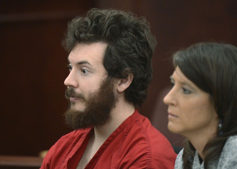 Accused Aurora theater gunman James Holmes listens with public defender Tamara Brady at his arraignment in Centennial, Colorado (Reuters)
