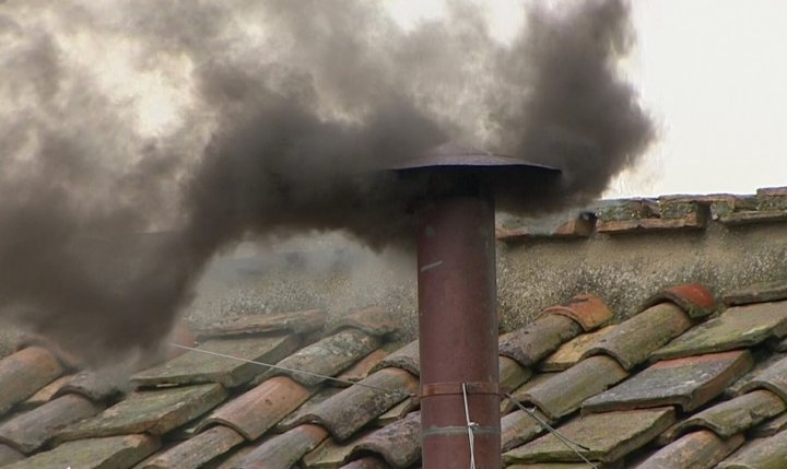Black smoke rises from the chimney on the Sistine Chapel