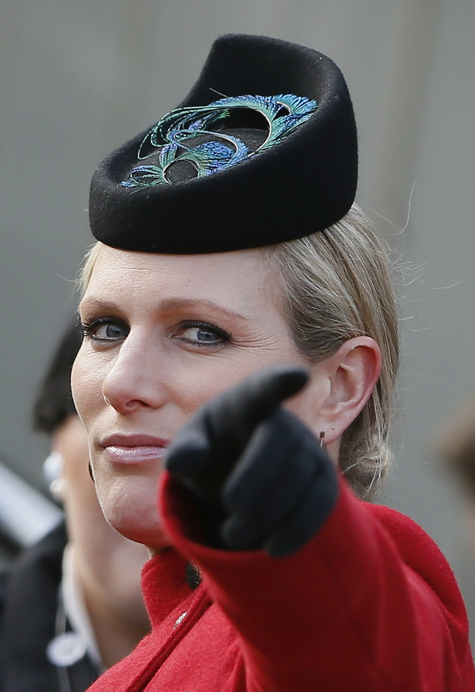 Britains Zara Phillips gestures in the unsaddling enclosure on Ladies Day at the Cheltenham Festival horse racing meet in Gloucestershire, western England, March 13, 2013.