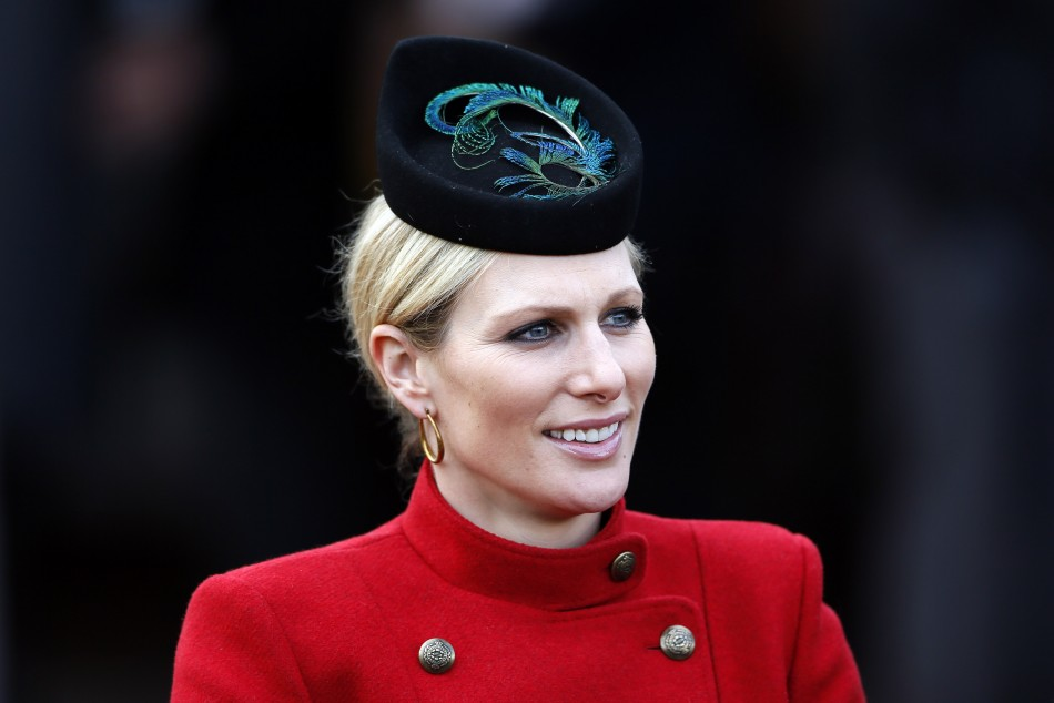 Britains Zara Phillips smiles in the unsaddling enclosure on Ladies Day at the Cheltenham Festival horse racing meet in Gloucestershire, western England, March 13, 2013.