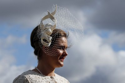 Racegoer Margaret Connolly poses in her hat on Ladies Day, the second day of racing at the Cheltenham Festival horse racing meet in Gloucestershire, western England March 13, 2013.