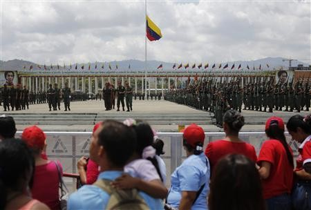 Military cadets practise a drill for Friday's parade to honour Venezuela's late President Hugo Chavez, at the military academy in Caracas March 14, 2013.