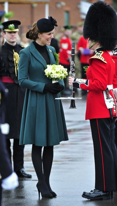 Britains Catherine, Duchess of Cambridge speaks to a soldier during a visit with her husband, Prince William, to attend a St Patricks Day Parade at Mons Barracks in Aldershot, southern England March 17, 2013. Prince William attended the Parade