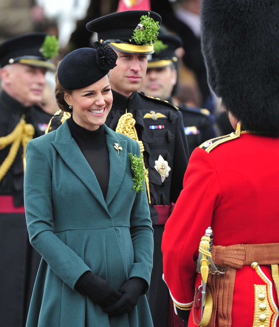 Britains Catherine, Duchess of Cambridge smiles during a visit with her husband, Prince William 3rd L, to attend a St Patricks Day Parade at Mons Barracks in Aldershot, southern England March 17, 2013. Prince William attended the Parade as C