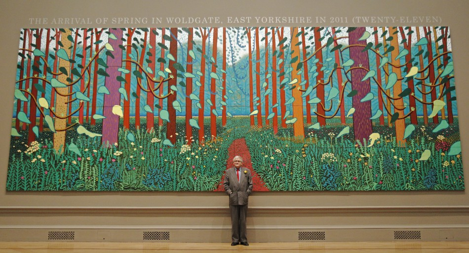 David Hockney poses with his painting