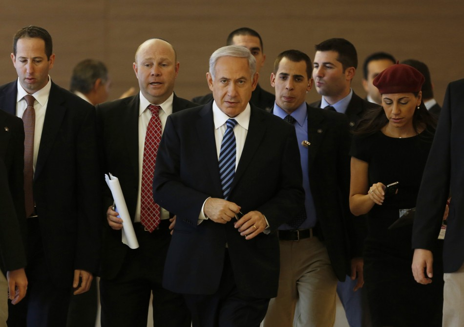 Israel's Prime Minister Benjamin Netanyahu (C) arrives to a Likud party meeting at the Knesset, the Israeli parliament, in Jerusalem March 18, 2013. Netanyahu's new governing coalition prepared to take office after a parliamentary vote on Monday with powerful roles reserved for supporters of settlers in occupied territory