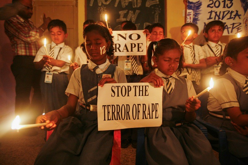 Students hold candles during prayer for Delhi gang rape victim
