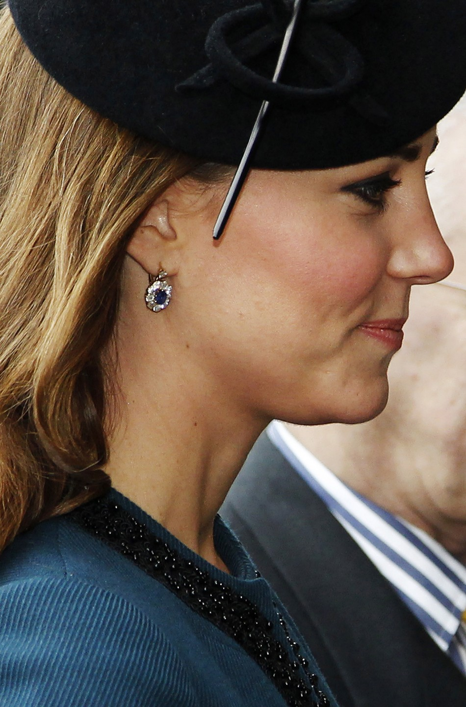 The Duchess of Cambridge wore a short teal Malene Birger coat and black hat
