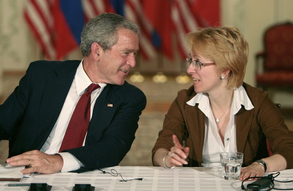 U.S. President George W. Bush speaks with Irina Yasina, representing Open Russia, as they participate in a roundtable discussion with Civil Society in St Petersburg, Russia, July 14, 2006