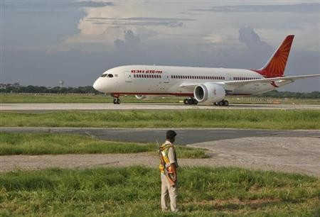 A security personnel stands guard as Air India's Dreamliner Boeing 787 taxies upon its arrival at the airport in New Delhi September 8, 2012.