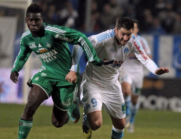 Kurt Zouma (L) battles for the ball with Marseille's Andre-Pierre Gignac
