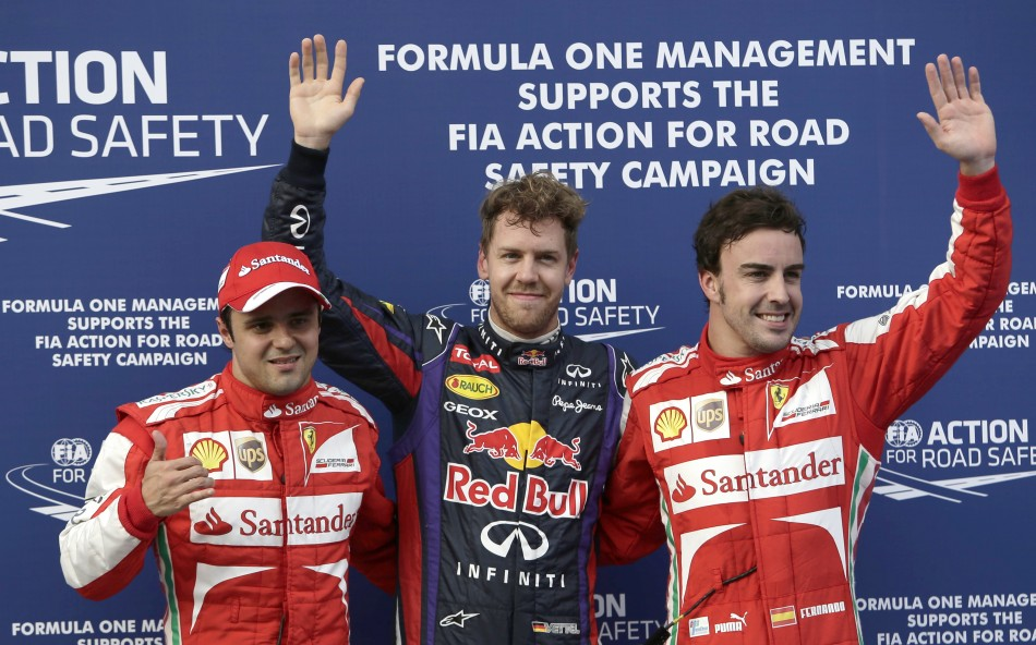 Red Bull's Sebastian Vettel, flanked by Ferrari's Felipe Massa (L) and Fernando Alonso