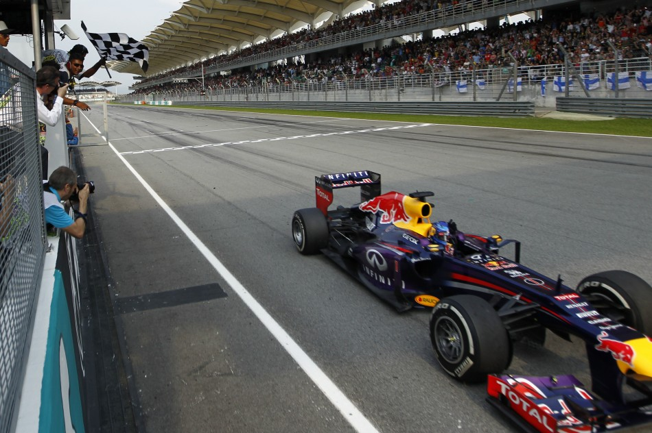 Sebastian Vettel takes the chequered flag