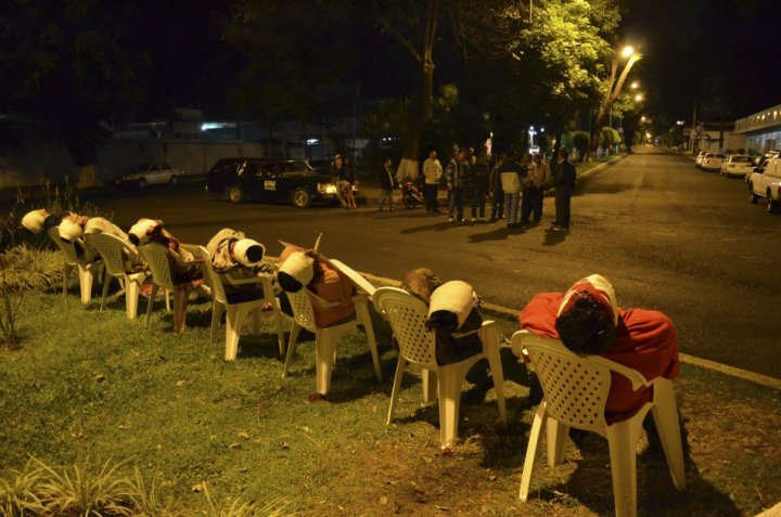 The bodies of seven men arranged in chairs are pictured in Uruapan, in the Mexican state of Michoacan (Reuters)