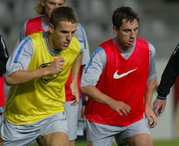 The father of  Phil Neville (L) and his brother Gary has been arrested (Reuters)