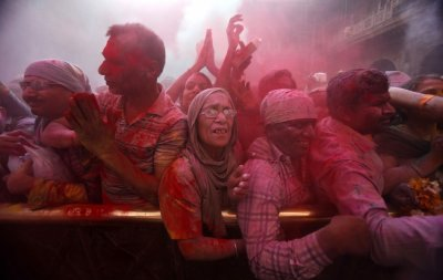 Hindu devotees stand amid a cloud of red coloured powder during Holi celebrations at the Bankey Bihari temple in Vrindavan in the northern Indian state of Uttar Pradesh March 26, 2013. Holi, also known as the Festival of Colours, heralds the beginning of