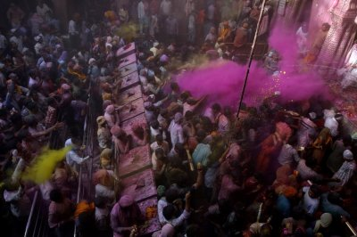Hindu devotees throw coloured powder during Holi celebrations at the Bankey Bihari temple in Vrindavan in the northern Indian state of Uttar Pradesh March 26, 2013. Holi, also known as the Festival of Colours, heralds the beginning of spring and is celebr