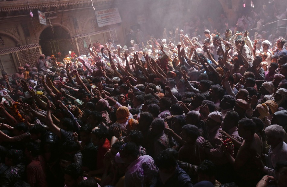 Hindu devotees gather during Holi celebrations at the Bankey Bihari temple in Vrindavan in the northern Indian state of Uttar Pradesh March 26, 2013. Holi, also known as the Festival of Colours, heralds the beginning of spring and is celebrated all over I