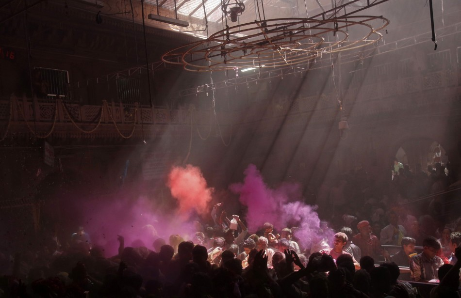 Hindu devotees throw coloured powder into the air during holi celebrations at the Bankey Bihari temple in Vrindavan in the northern Indian state of Uttar Pradesh March 25, 2013. Holi, also known as the Festival of Colours, heralds the beginning of spring