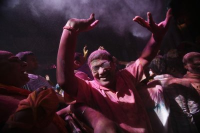 A man dances during holi celebrations at the Bankey Bihari temple in Vrindavan in the northern Indian state of Uttar Pradesh March 25, 2013. Holi, also known as the Festival of Colours, heralds the beginning of spring and is celebrated all over India.