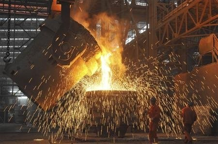 Laborers work at a steel factory in Dalian, Liaoning province July 13, 2012.