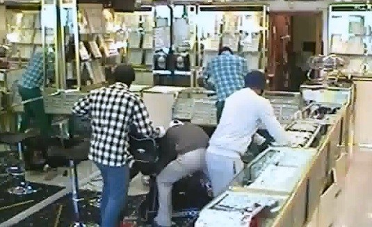 The gang made off with more than £1m worth of goods during the raids  (Met Police)