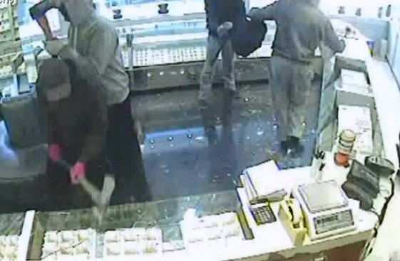 The men used weapons such as sledgehammers and axes during the robberies (Met Police)
