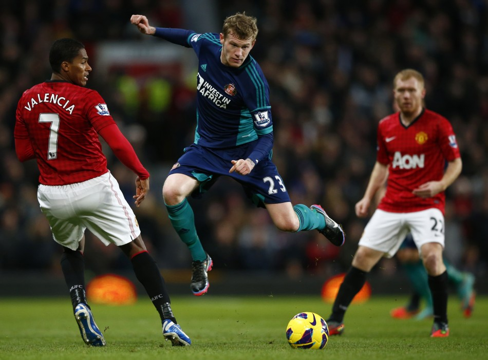 Antonio Valencia (L) and James McClean (C)