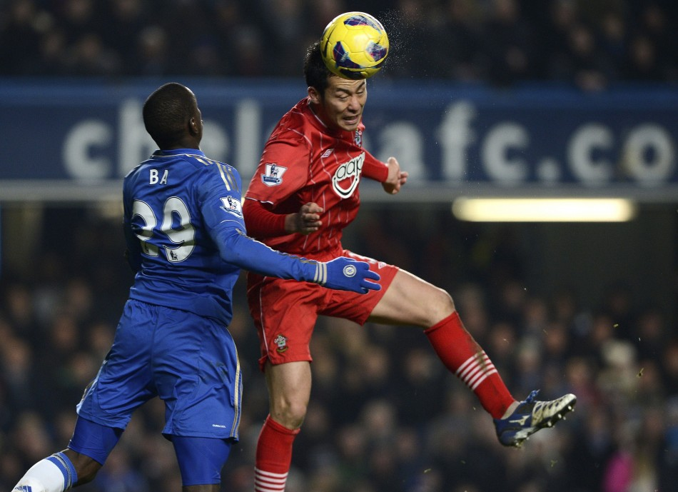 Demba Ba (L) and Maya Yoshida