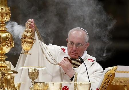 Pope Francis holds the incense burner as he leads a vigil mass during Easter celebrations at St. Peter's Basilica in the Vatican March 30, 2013.