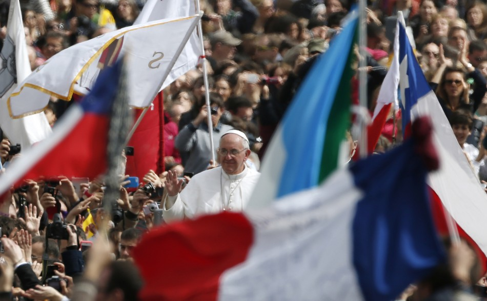 Pope Francis waves as he leaves at the end of the Easter mass in St. Peter's Square at the Vatican March 31, 2013.