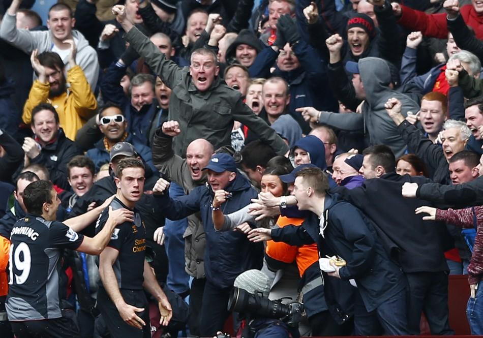 Jordan Henderson celebrates his goal against Aston Villa