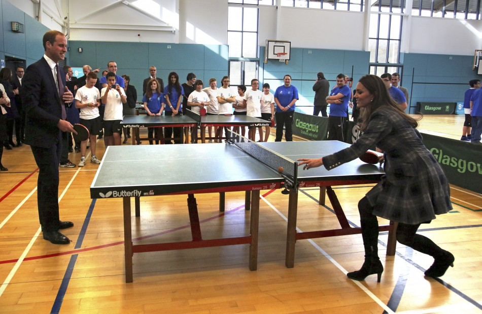 Britains Prince William and his wife Catherine, Duchess of Cambridge play table tennis during their visit to the Donald Dewar centre in Glasgow, Scotland April 4, 2013.