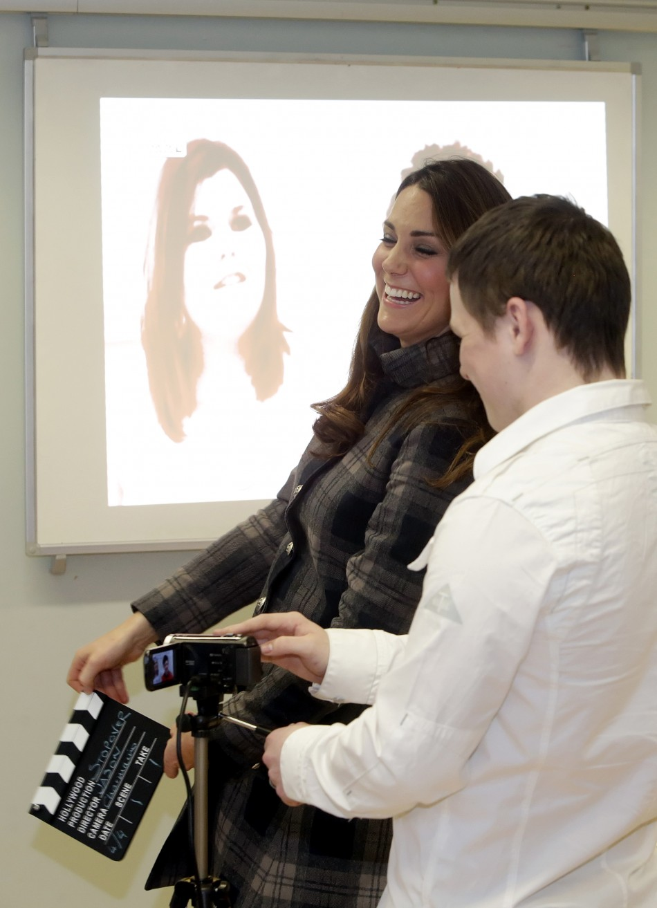 Britains Catherine, Duchess of Cambridge laughs during her visit to the Quarriers Stopover Project in Glasgow, Scotland April 4, 2013. The Quarriers Stopover is a short-term residential unit for 14 young people aged between 16 and 25 who find themse