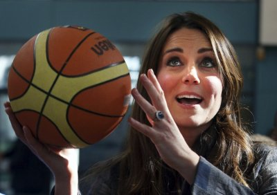 Britains Catherine, Duchess of Cambridge plays basketball during her visit to the Donald Dewar centre in Glasgow, Scotland April 4, 2013.