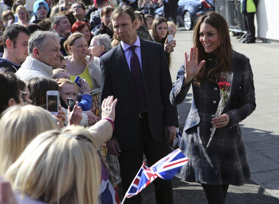 Britains Catherine, Duchess of Cambridge waves to well-wishers as she arrives at the Donald Dewar centre in Glasgow, Scotland April 4, 2013.