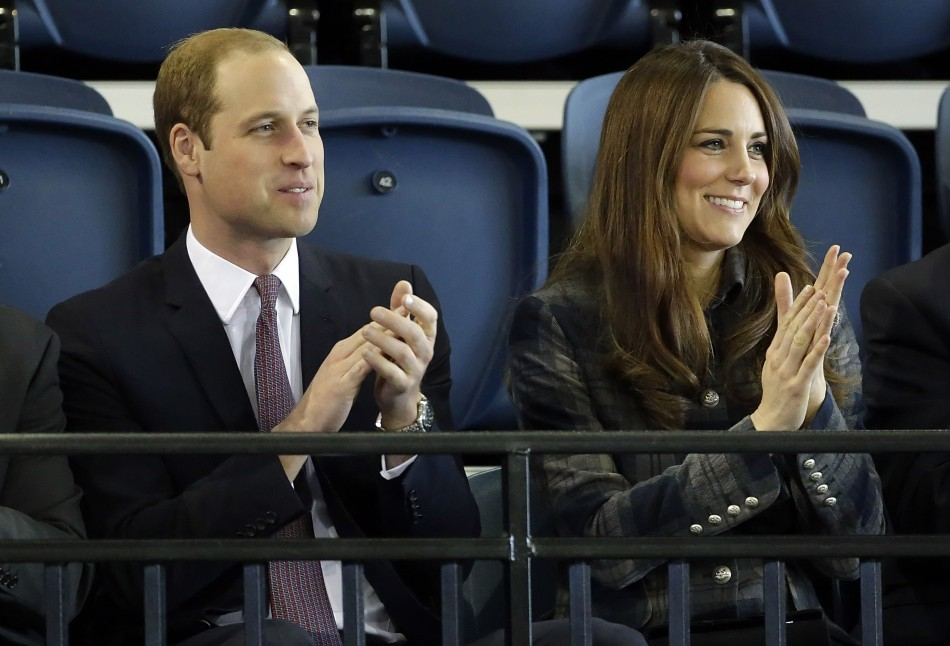 Britains Prince William and his wife Catherine, Duchess of Cambridge applaud during their visit to the Emirates Arena in Glasgow, Scotland April 4, 2013.