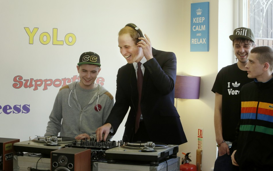 Britains Prince William C listens to music during his visit to the Quarriers Stopover Project in Glasgow, Scotland April 4, 2013. The Quarriers Stopover is a short-term residential unit for 14 young people aged between 16 and 25 who find themselve