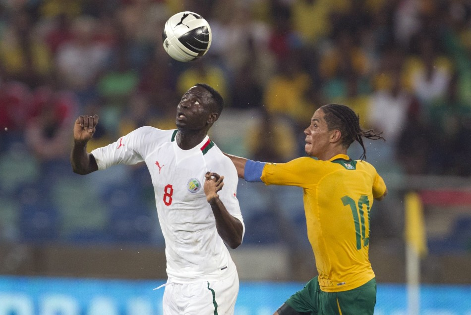 Cheikhou Kouyate (L) battles for the ball with South Africa's Steven Pienaar