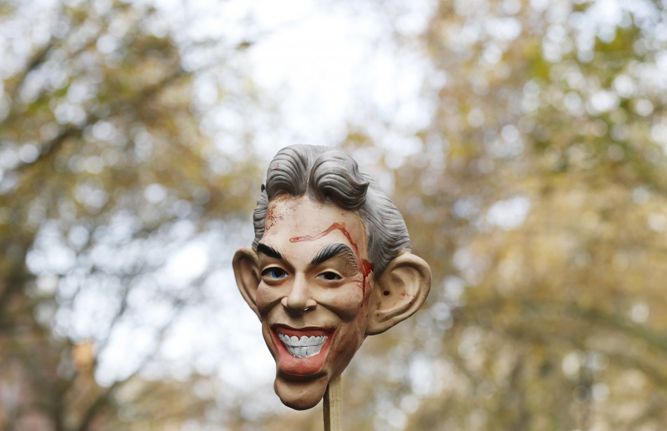 Bloodied mask of Blair brandished on a stick at a protest in London, last year