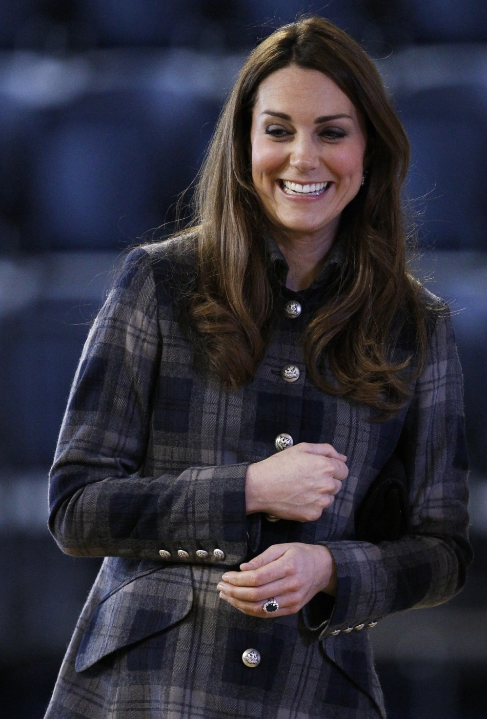 Britains Catherine, Duchess of Cambridge smiles during her visit to the Emirates Arena in Glasgow, Scotland April 4, 2013.
