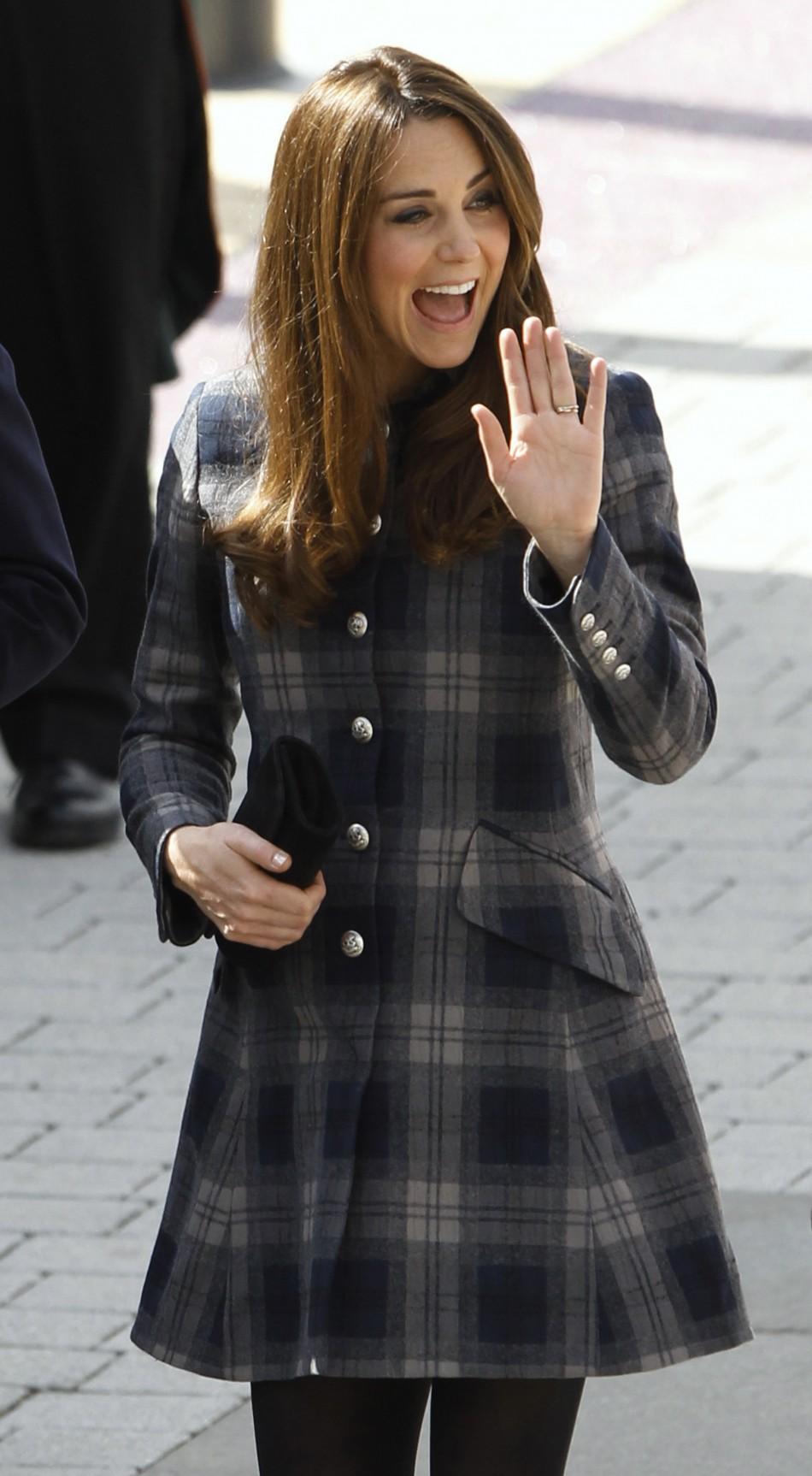 Britains Catherine, Duchess of Cambridge waves as she arrive for a visit to the Emirates Arena in Glasgow, Scotland April 4, 2013.