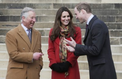 Catherine, Duchess of Cambridge speaks with Prince William R and Prince Charles as they visit Dumfries House in Ayrshire, Scotland April 5, 2013.