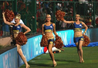 The Mumbai Indians cheerleaders entering the stadium during match 2 of of the Pepsi Indian Premier League between The Royal Challengers Bangalore and The Mumbai Indians held at the M. Chinnaswamy Stadium, Bengaluru on the 4th April 2013