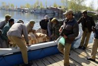 Indian police remove the body of a British woman from a motorboat on the banks of the Dal Lake in Srinagar