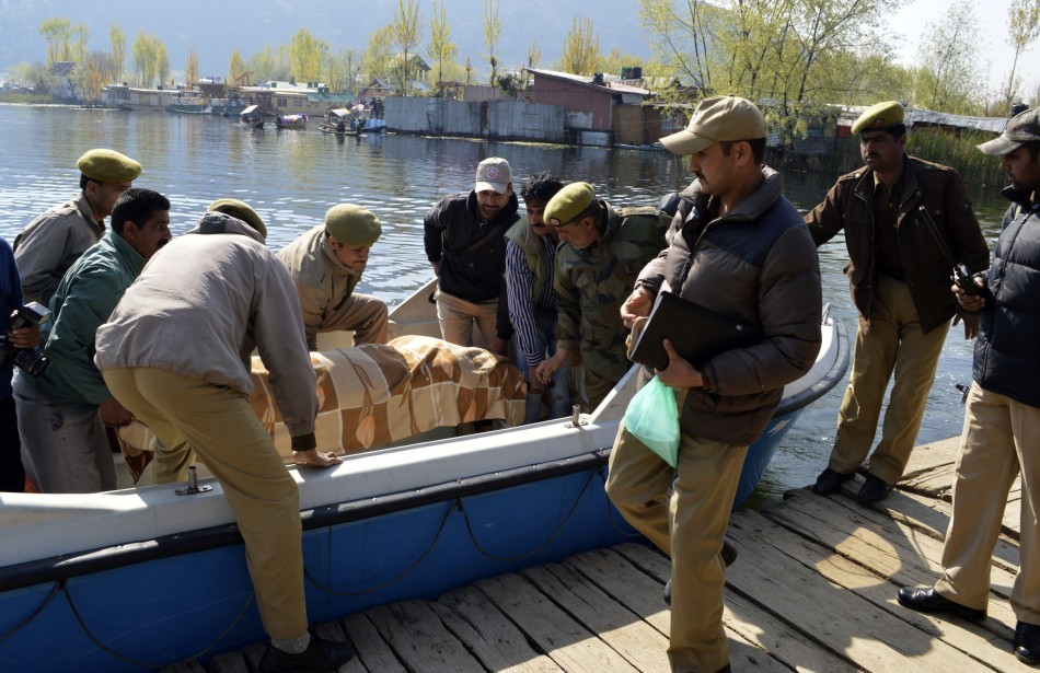 Indian police removed the body of a British woman found stabbed to death on a houseboat in Kashmir
